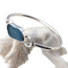 Beautiful vivid gray blue sea glass bracelet set in fine and sterling silver on a silver round bangle.
