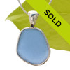 This TOP QUALITY piece of Carolina Blue sea glass is set in our Deluxe Wire Bezel© necklace pendant setting. This setting leaves the sea glass TOTALLY UNALTERED from the way it was found on the beach. One of our last larger pieces in this color. Sorry this sea glass jewelry piece has been sold!