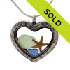 Seafoam Green and Carolina Blue sea glass heart combined with a real baby starfish in a silver heart in this sea glass locket necklace. Sorry this sea glass jewelry piece has been sold!
