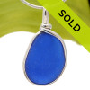 A nice piece of Cobalt Blue with in our signature Original Wire Bezel© pendant setting that leaves both front and back open and the glass unaltered from the way it was found on the beach. Sorry this sea glass jewelry piece has been sold!