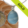 A  natural beach found mixed blue sea glass set in our Deluxe Wire Bezel© Sorry this one of a kind sea glass jewelry piece has been sold!