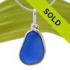 A PERFECT piece of Bright Blue with in our signature Original Wire Bezel© pendant setting that leaves both front and back open and the glass unaltered from the way it was found.