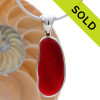 A long Cherry Red Sea Glass Pendant for a necklace set in our Deluxe Silver Bezel Setting. SOLD - Sorry this Rare Sea Glass Pendant is NO LONGER AVAILABLE!