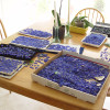 Sorting blue sea glass for earrings. It can take hundreds of pieces of sea glass to find a perfect match. All of our sea glass is UNALTERED from the way it was found on the beach!