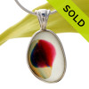 A beautiful and ultra rare mixture of colors fused on a pure white sea glass piece. This piece is set in our Original Wire Bezel© setting and leaves this amazing natural sea glass piece UNALTERED from the way it was found on the beach! SOLD - Sorry This ULTRA RARE Sea Glass Jewelry Pendant  Is NO LONGER AVAILABLE!