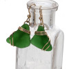 A simple secure setting that maximizes the bling of gold yet leaves much of the sea glass open.