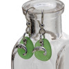 A simple pair of genuine green sea glass earrings with dolphin charms in a lightweight simple setting.