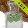A simple pair of genuine green sea glass earrings with sterling dolphin charms in a lightweight simple setting. Sorry, this sea glass jewelry selection has been sold!