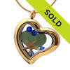 A stunning gold tone stainless steel locket necklace with a green heart shaped beach found sea glass and a real starfish and sapphire crystals gems. Sorry this sea glass jewelry piece has been sold!