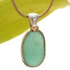A stunning thick piece of genuine UNALTERED sea glass in an elegant setting.  A perfect and LARGE piece of vivid Aqua Green sea glass from the UK in our In NEW Deluxe Sterling Wire Bezel© Setting that leaves the glass just the way it was found on the beach.