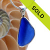 A nice piece of Vivid Blue Genuine Sea Glass with in our signature Deluxe Wire Bezel© pendant for necklace. Sorry this one of a kind sea glass jewelry piece has been sold!