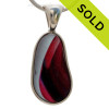 A vivid mix of hot pink, purple and pale blue endoday sea glass from England set in our Original Wire Bezel© necklace pendant setting.