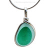 A stunning piece - This photo does not do it justice. Very 3 dimensional colors that are fused inside this 150 year old sea glass piece found in Seaham England.