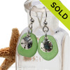 A simple pair of genuine green sea glass earrings with sterling silver sandollar charms in a lightweight simple setting. Sorry this Sea Glass Jewelry selection has been SOLD!