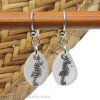 Beach found white sea glass earrings with solid sterling sea horse charms.