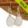 A lovely pair of pure white English sea glass earrings in our Original Bezel Wire© setting in solid sterling silver.  This amazing thick and frosty genuine sea glass from Seaham England captures and holds the light to make this beach found sea glass gems shine. One does have a small crizzle line but only adds to the authenticity of the glass.