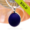 A perfect and piece of vivid Midnight Blue sea glass from the UK in our In Deluxe Sterling Wire Bezel© Setting that leaves the glass just the way it was found on the beach.