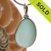 A P-E-R-F-E-C-T piece of beach found glass from Seaham England in aqua is set in our Original Wire Bezel© pendant setting. Sorry this piece of sea glass jewelry has been sold!