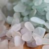 There are many sea glass pieces that may appear white but when put in a pile of similar color, the slightest hues appear like aqua, purple and peach.