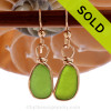 Unusual Genuine beach found lime green sea glass earrings in a 14K Rolled Gold Original Wire Bezel setting. Very unusual Chartreuse or Lime green perfectly matched sea glass pieces. REMEMBER- We do no alter or shape our sea glass in any way. Sorry this sea glass jewelry selection has been sold!