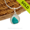 An vivid Electric Aqua spotted English Multi sea glass set for a necklace in our Original Sea Glass Bezel© in solid sterling silver setting. Sorry this piece of sea glass jewelry has been sold!