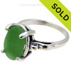 A natural UNALTERED unusual bright green sea glass piece set in a sterling silver scroll ring. Sorry this piece of Genuine Sea Glass Jewelry has been SOLD!