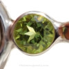 """A genuine brilliant cut peridot 4MM gem is set in a """"tube bezel"""" setting. This is NOT a glued setting but painstakingly burnished to enclose the gem."""
