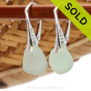 A pair of natural surf tumble sea glass earrings in a brilliant seafoam or sea green on solid sterling leverbacks. Sorry these Sea Glass Earrings have been SOLD!