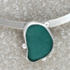 A detail of the sea glass pendant for this necklace shows you the vivid aqua color and the seperation of the glossy finished beads against a satin finished bezel.