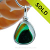 A beautiful piece of tri color multi  teal green  with gold sea glass set for a necklace in our Original Sea Glass Bezel© in solid sterling silver setting. SOLD - sorry this Sea Glass Jewelry selection is NO LONGER AVAILABLE!