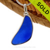 SOLD - Sorry This Sea Glass Jewerly Selection Is NO LONGER AVAILABLE! A curved piece of Cobalt Blue Genuine Sea Glass with in our signature Original Wire Bezel© pendant setting in Sterling Silver.