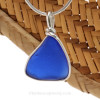 A curved piece of Cobalt Blue Genuine Sea Glass with in our signature Original Wire Bezel© pendant setting in Sterling Silver.