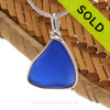 A curved piece of Cobalt Blue Genuine Sea Glass Jewelry in our signature Original Wire Bezel© pendant setting in Sterling Silver. SOLD - Sorry this Sea Glass Pendant is NO LONGER AVAILABLE!