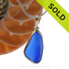 A curvy piece of Cobalt Blue Genuine Sea Glass with in our signature Original Wire Bezel© pendant setting in Sterling Silver. Sorry this piece of sea glass jewelry has been SOLD!