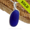 A wonderful shaped thick piece of vivid intense Cobalt Blue sea glass in our In Our Deluxe Sterling Wire Bezel© necklace pendant. Sorry this Sea Glass Jewelry selection has been SOLD!