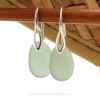 Simple beach found green sea glass earrings on solid sterling silver deco hooks.