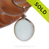 A P-E-R-F-E-C-T piece of white with a hint of green sea glass in our Original Wire Bezel© necklace pendant in 14K Goldfilled setting. Sorry this Sea Glass Jewelry selection has been SOLD!