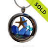 A beautiful pieces of Genuine blue Sea Glass combined in a stainless steel locket necklace with a real starfish. Sorry this Sea Glass Locket has been SOLD!