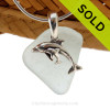 """Pale seafoam green sea glass set on a solid sterling cast bail with a sterling silver Mother and Baby Dolphins charm. The sea glass necklace comes on our 18"""" solid sterling smooth snake chain (SHOWN and included)"""