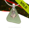 A rarer Seaweed or Jungle Green sea glass necklace set on a solid sterling cast bail with a sterling silver Turtle charm. Sorry this Sea Glass Jewelry selection has been SOLD!