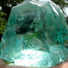 Shown Here - Modern day aqua green slag glass. This is an end byproduct in glassmaking and in the Seaham case, this type of glass was discarded into the North Sea over 150 years ago to from the sea glass piece in the ring. This is why sea glass from this area tends to be very thick and round.