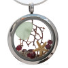 A Beautiful piece of Seafoam green beach found sea glass, a real starfish and genuine garnet gems in a stainless steel locket combined with Crystal Garnet faceted gem.