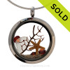 A pure white beach found sea glass, a real starfish and genuine garnet gems in a stainless steel locket combined with Genuine Garnet crystal gems. SOLD - Sorry this Sea Glass Locket is NO LONGER AVAILABLE!