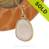 A nice pure white natural sea glass piece set in our Original Wire Bezel setting in 14K Rolled Gold setting. Shown here on our 1.6 MM snake chain which is available as an upgrade. SOLD - Sorry this Sea Glass Pendant is NO LONGER AVAILABLE!