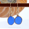 This Victorian era sea glass earring pair. A beautiful vivid blue set in a gold bezel setting Unique and special!