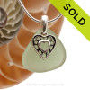 A  perfect piece of pale green peridot genuine sea glass with a solid sterling bail and detailed heart charm. SOLD - Sorry This Sea Glass Necklace Is NO LONGER AVAILABLE!