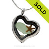 Seafoam Green Beach Found Sea Glass combined a silver heart locket necklace with Fresh Water Pearls and a a baby starfish.