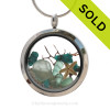 Beautiful pieces of natural aqua Genuine beach found Sea glass combined in a stainless steel locket necklace with a real starfish. SOLD - Sorry this Sea Glass Locket is NO LONGER AVAILABLE!