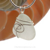 A small perfect White Sea Glass Pendant is set in our popular Sea Swirl setting in sterling silver.