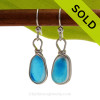 Vivid flashed Electric Aqua Sea Glass Earrings set in our Original Wire Bezel© setting. Awesome sea glass from Seaham England where art glass factories discarded scraps into the North Sea.